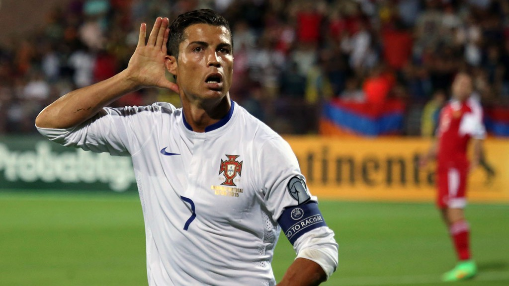 Portugal's Cristiano Ronaldo gestures after scoring the second goal against Armenia during the Euro 2016 Group I qualifying match between Armenia and Portugal in Yerevan, Armenia, Saturday, June 13, 2015. (Hrant Khachatryan/PAN Photo via AP)