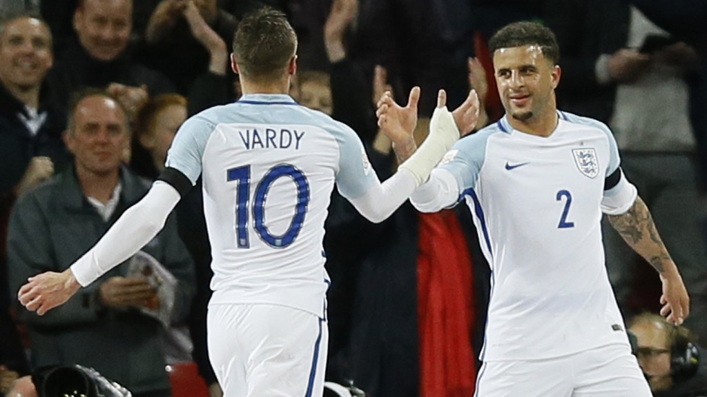 England's Jamie Vardy, left, is congratulated by Kyle Walker after Vardy scored his side's first goal during the international friendly soccer match between England and The Netherlands at Wembley stadium in London, Tuesday, March 29, 2016. (AP Photo/Kirsty Wigglesworth)