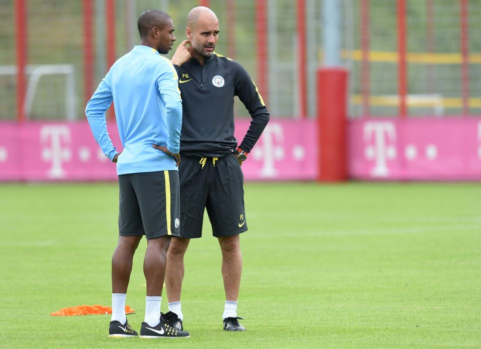 Manchester's new Spanish headcoach Pep Guardiola (R) speaks with Manchester's Brazilian midfielder Fernandinho Roza (L) during a training session of Manchester City at the training ground of the German first division football team FC Bayern Munich in Munich, southern Germany, on July 21, 2016. / AFP PHOTO / CHRISTOF STACHECHRISTOF STACHE/AFP/Getty Images