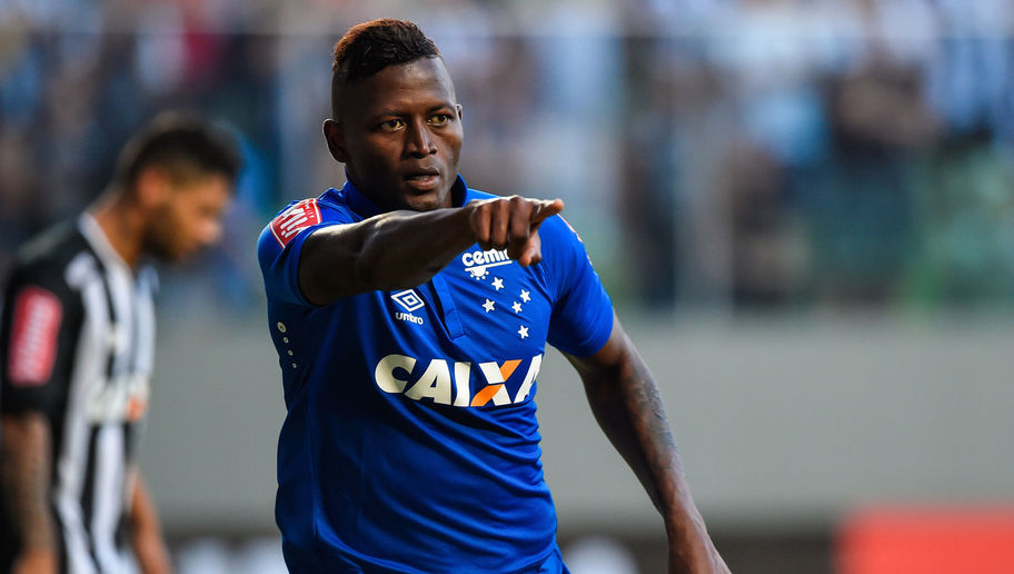 BELO HORIZONTE, BRAZIL - JUNE 12: Riascos #18 of Cruzeiro celebrates a scored goal against Atletico MG during a match between Atletico MG and Cruzeiro as part of Brasileirao Series A 2016 at Independencia stadium on June 12, 2016 in Belo Horizonte, Brazil. (Photo by Pedro Vilela/Getty Images)